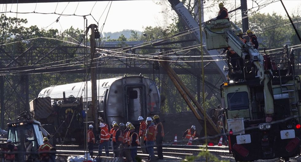 Amtrak train may have been hit by a 'projectile' before fatal derailment: officials