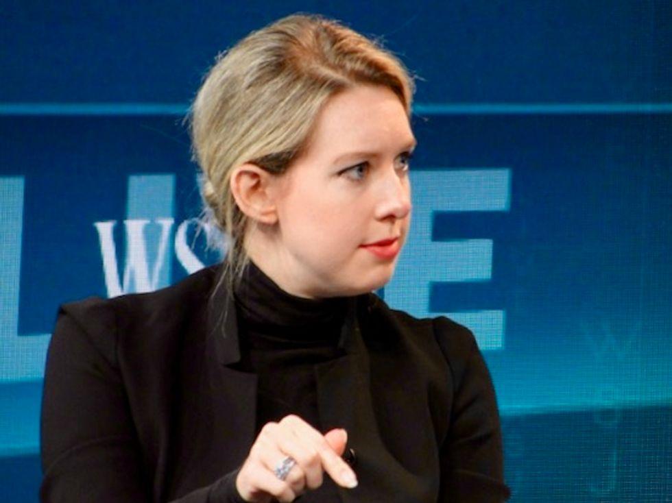 Theranos founder Elizabeth Holmes steps down as CEO