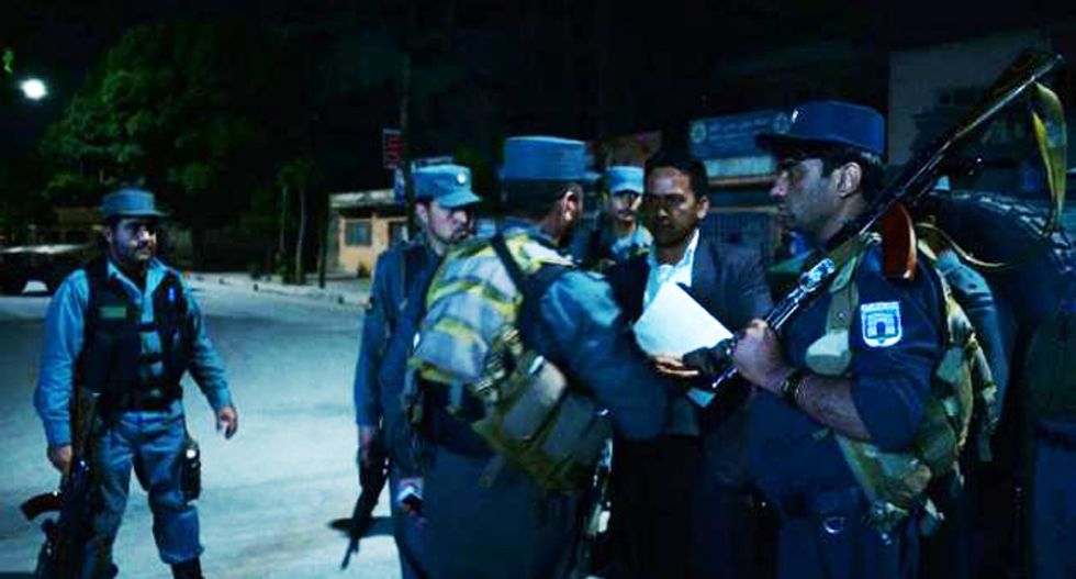 American among five dead in Kabul guesthouse siege