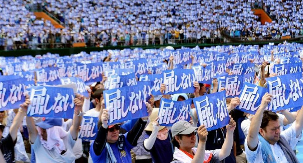 Thousands rally against US military base on Japan's Okinawa