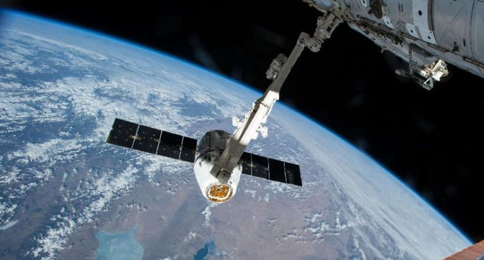 SpaceX cargo ship returns to Earth in ocean splashdown