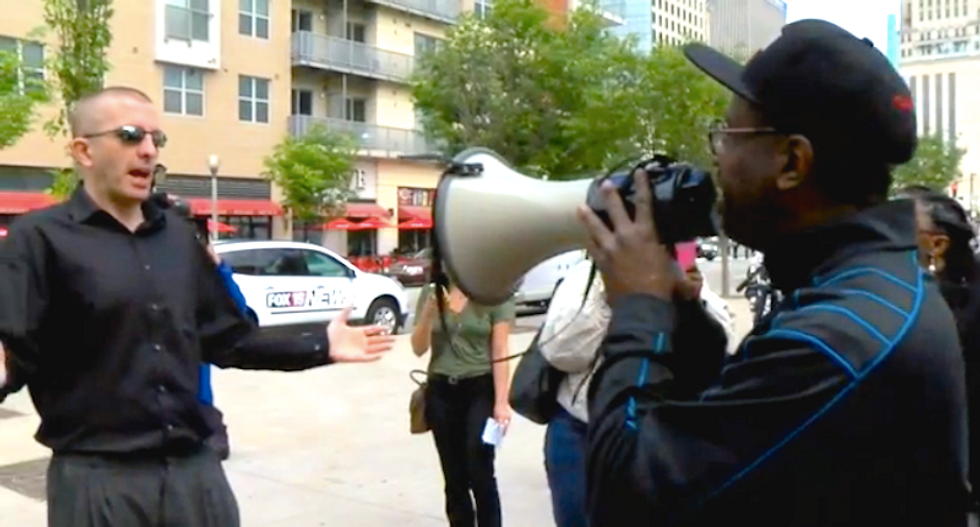 Angry white people shout down protest against 'racist' prosecution of black Ohio judge