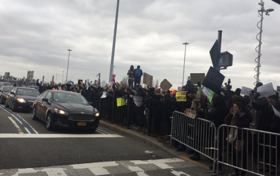 'Let them in!': Protesters gather at JFK Airport to shout down Trump's 'unjust' immigrant detentions