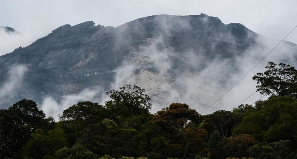 Malaysia to deport four 'earthquake-causing' Westerners over nude photos on sacred peak