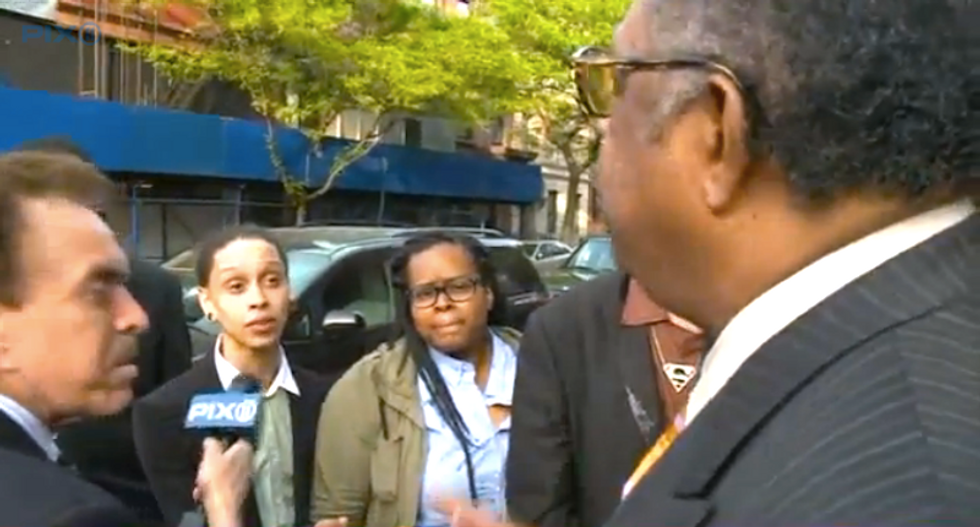 WATCH: Angry neighbors call out gay-hating Pastor Manning for absurd slogans outside Harlem church
