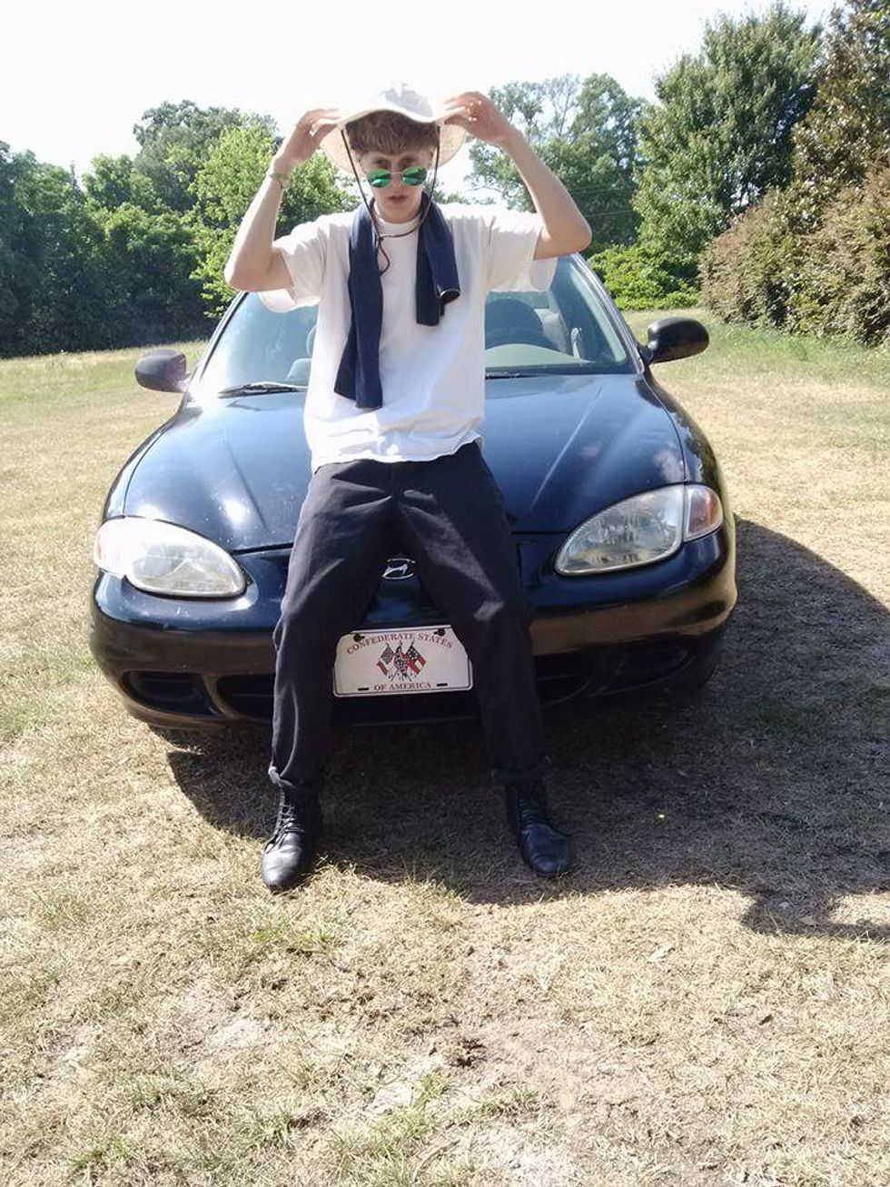 Dylann Roof in front of his car (Facebook)