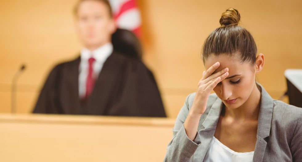 Poor people rely on public defenders who are too overworked to defend them