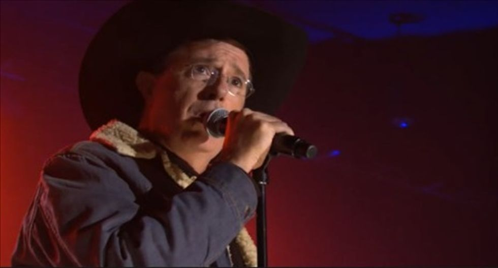 Why the hell is Stephen Colbert dressed up like Toby Keith? Find out here