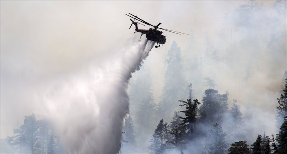 'We are surrounded': Firefighters battle massive blazes from Alaska to drought-hit California