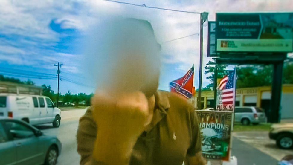 Irate middle-finger waving Confederate flag vendor stalks CNN reporter: 'You're stirring sh*t up'