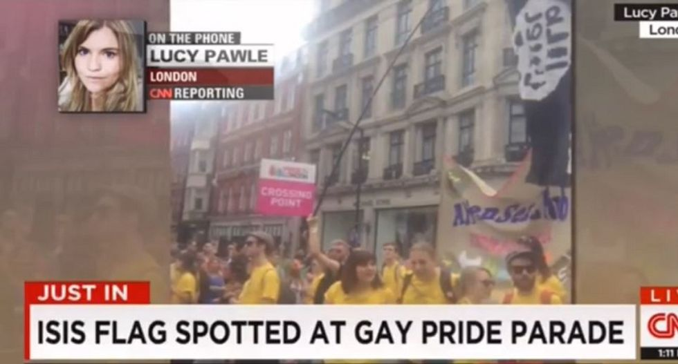 Man trolls ISIS at LGBT pride event with fake penis flag — and CNN thinks it's real