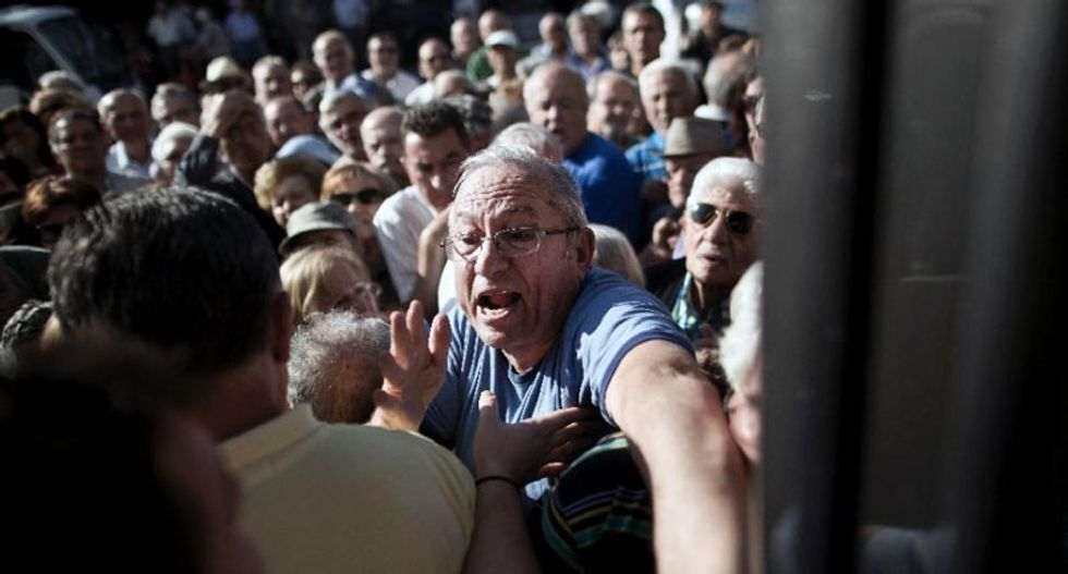 Thousands of angry elderly Greek pensioners besiege banks to grab cash