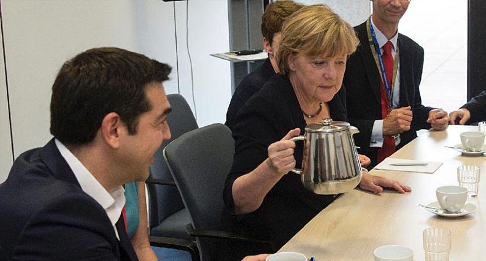Economists Thomas Piketty and others urge Germany's Angela Merkel to cut Greek debt