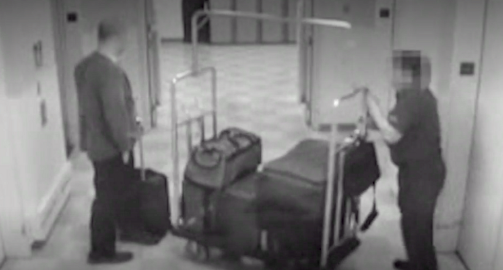 Chilling video shows hotel staffers unwittingly deliver 'bag after bag' of weapons for Las Vegas gunman