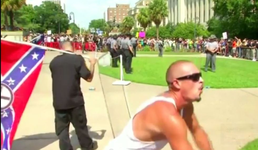 WATCH: KKK supporter uses 'gorilla' taunts to mock black crowd during tense Confederate flag rally