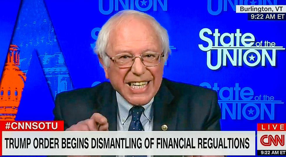 'This guy is a fraud': Bernie Sanders blasts Trump for selling out voters to help Wall Street
