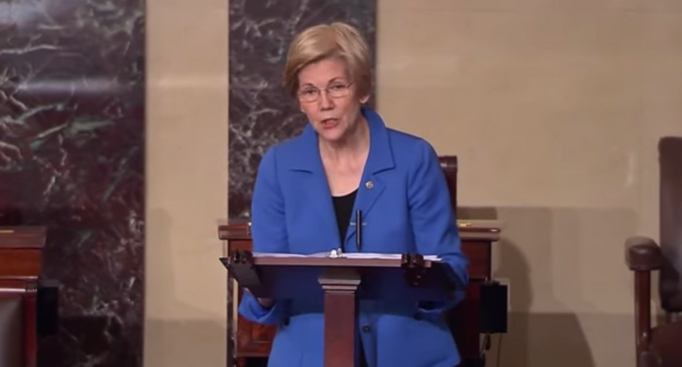 WATCH: Elizabeth Warren shames Mitch McConnell by reading directly from Mueller report on the Senate floor