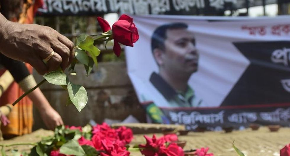 Secular bloggers go into hiding after fourth atheist hacked to death with machetes in Bangladesh
