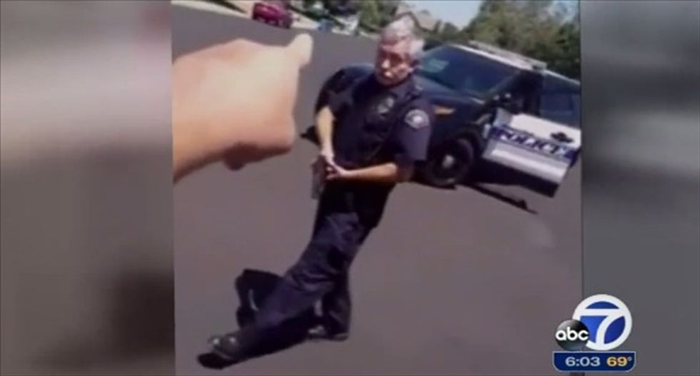 WATCH: Calif. cop draws his gun after resident films him from his own driveway