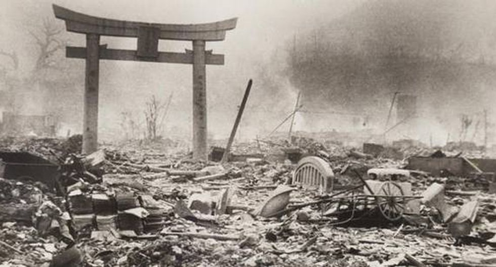 Japan's prime minister criticized for attempting to expand military as country observes Nagasaki anniversary