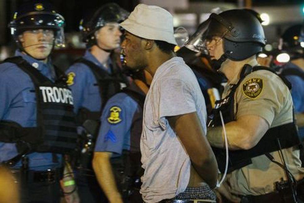 St Louis County police officers arrest an anti-police demonstrator in Ferguson, Missouri August 10, 2015. REUTERS/Lucas Jackson