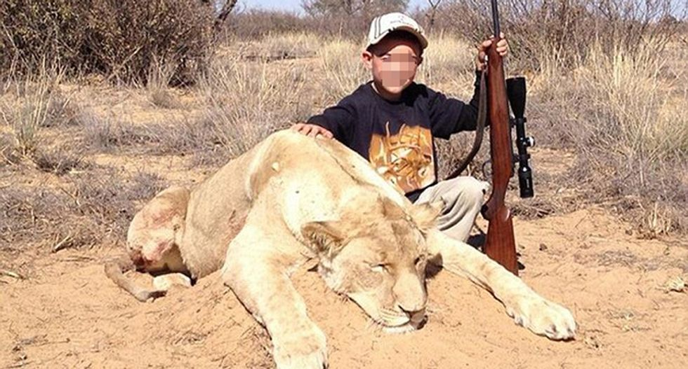 7-year-old boy with lion he killed - Twitter