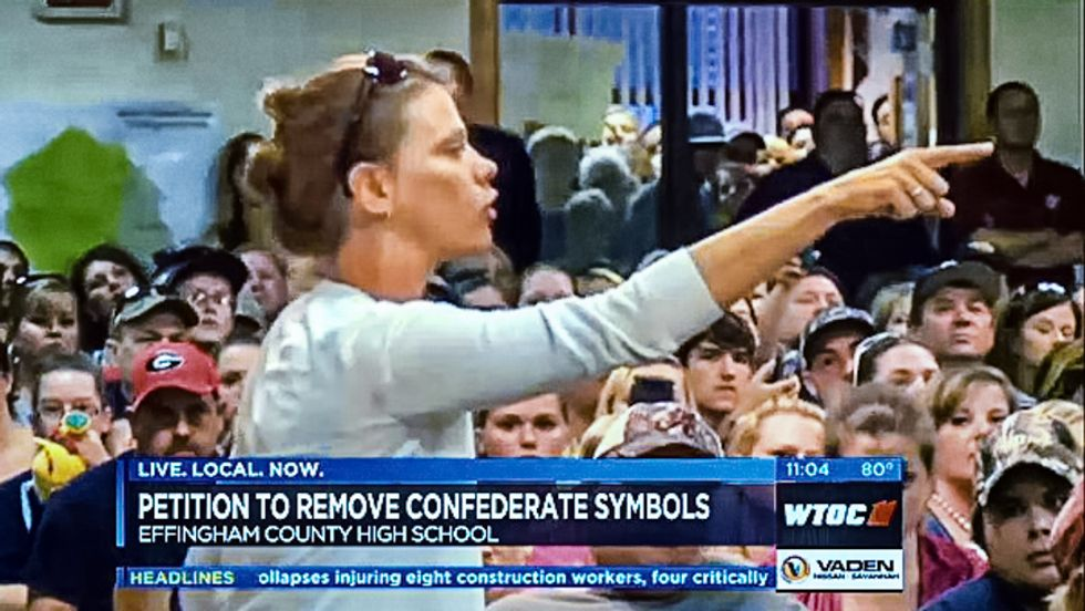 WATCH: White school board crowd boos NAACP, call blacks 'racist' over objection to 'Dixie' fight song