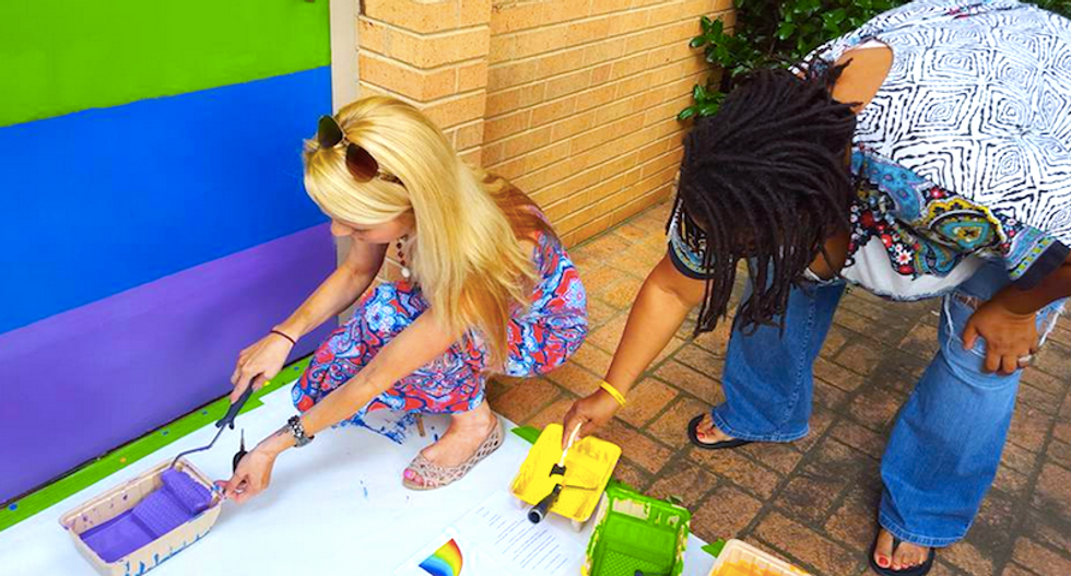 NC church turns the tables on anti-gay bigots by painting a giant rainbow over 'f*gs are pedos' graffiti