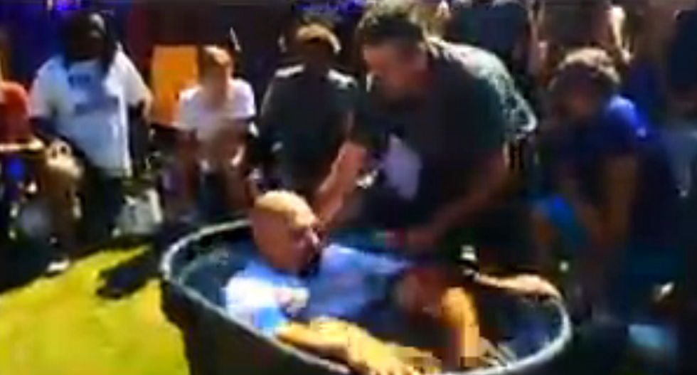 'God is STILL in our schools!': Video shows mass baptism at public high school football practice