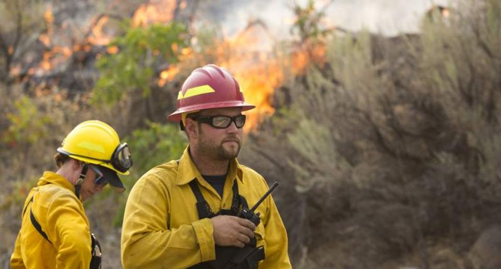 Largest wildfire in Washington state history destroys 176 homes and more than 300,000 acres