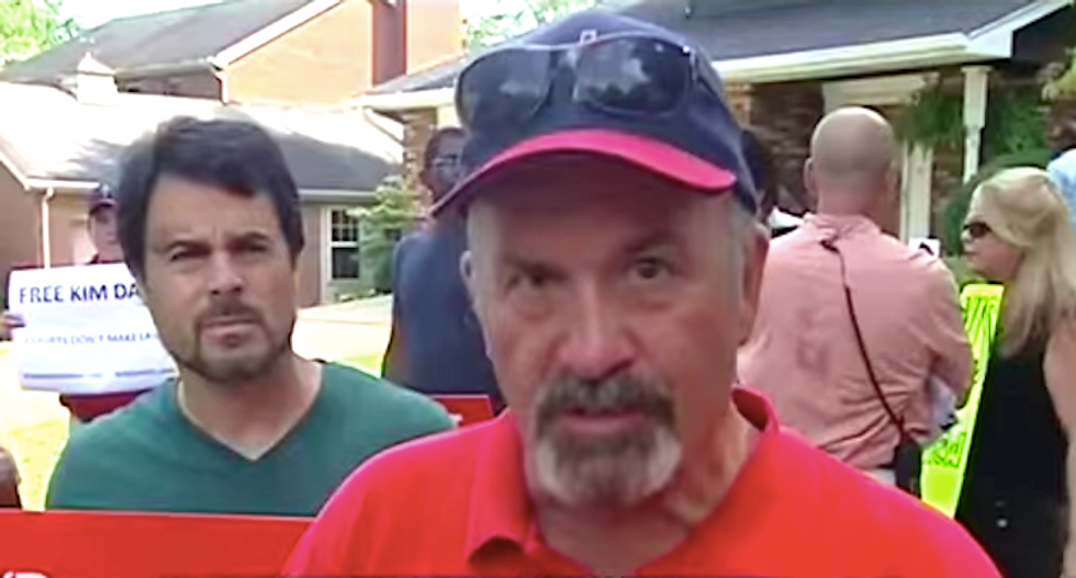 Kim Davis supporters gather outside judge's home to hold him 'in contempt of God's court'