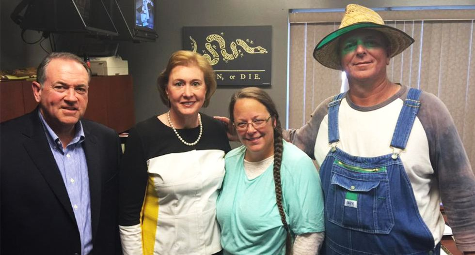 Mike Huckabee and Kim Davis' overalls-clad husband get the Twitter treatment — and it's hilarious