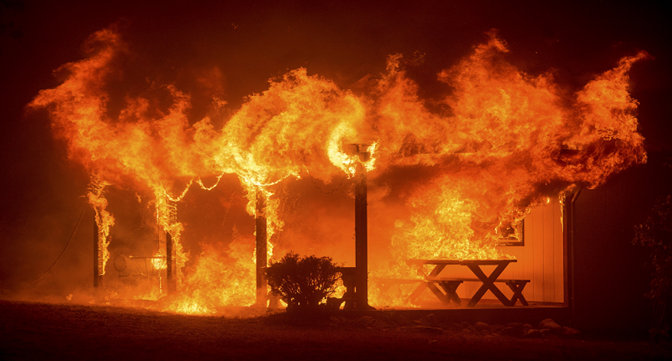 Fast-moving Sierra wildfire destroys homes, threatens 6,000 California residences