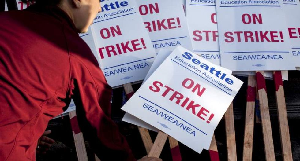 Seattle schools shut for second day as teachers continue strike over pay and hours