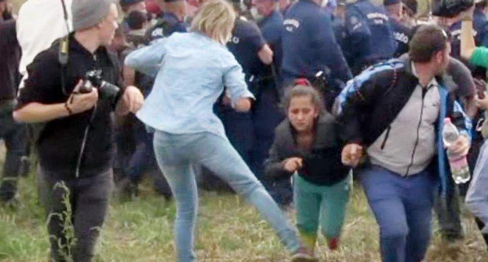 Hungarian camerawoman 'regrets' kicking refugees