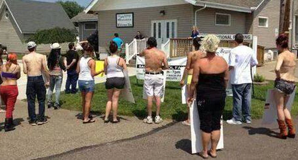 9-year-long church vs strip club war continues as pastor sues over topless protesters