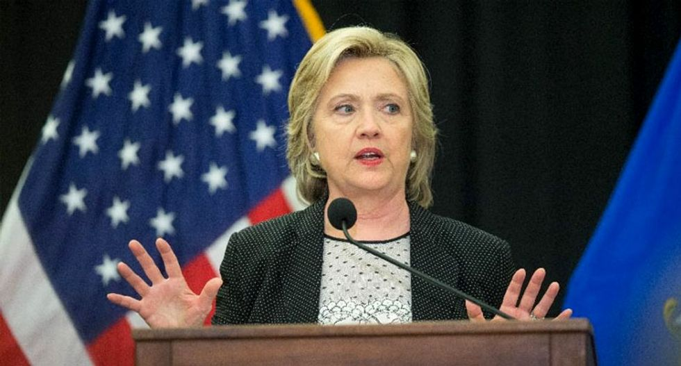 Clinton shrugs off slumping poll numbers, looks to debate