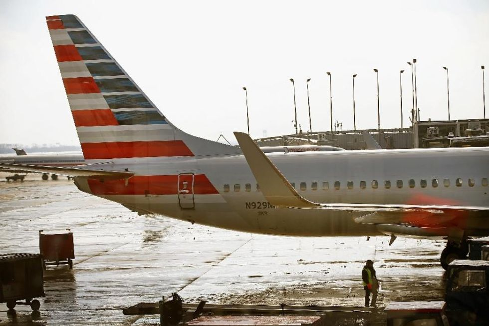 American Airlines ordered passengers to stop social distancing — because they hadn't paid for exit seats