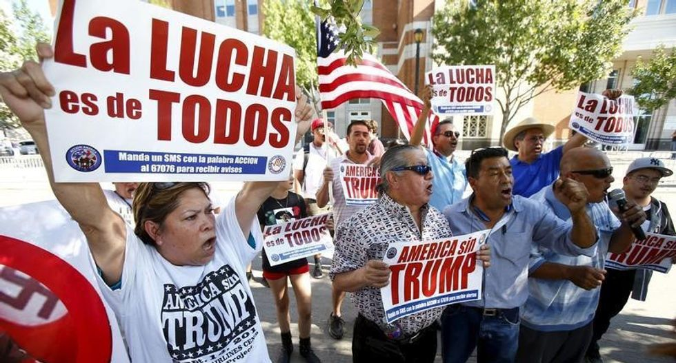 Hundreds of Latinos protest at Trump rally in downtown Dallas, clash with supporters