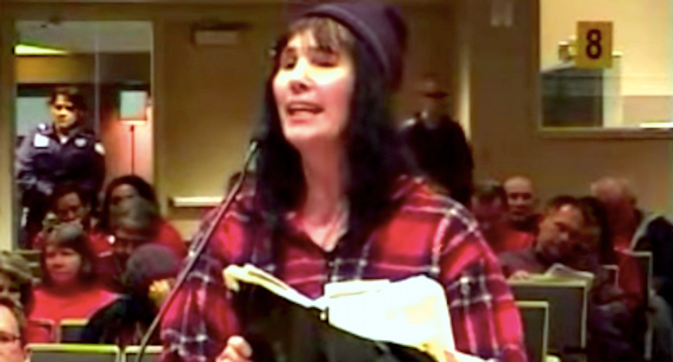 WATCH: Tampon-waving woman demands officials protect her right to speak in tongues amid anti-gay rant