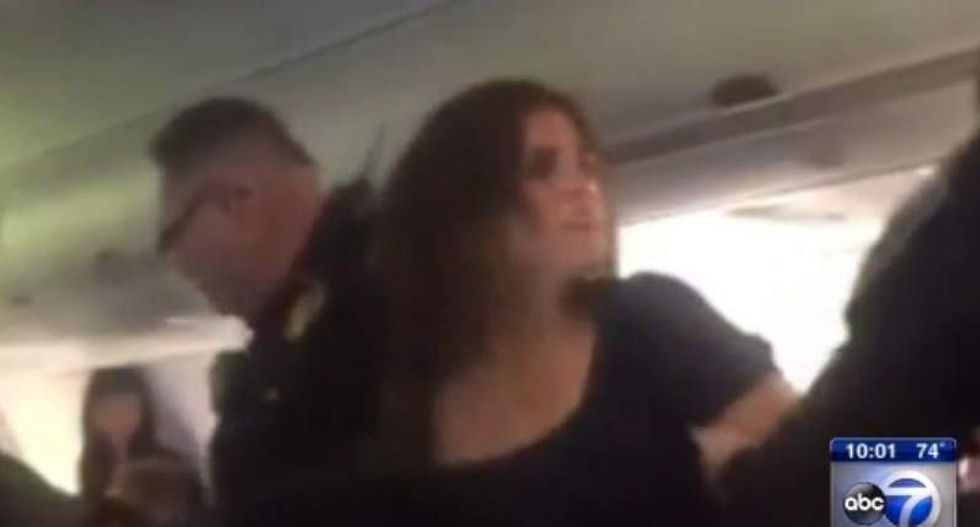 Belligerent woman booted off plane after screaming and hitting passenger and attendant