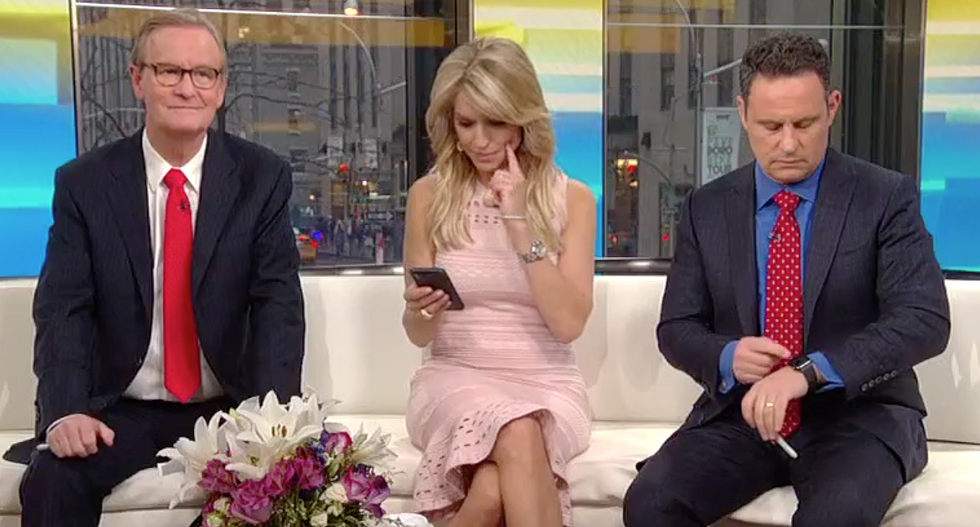 Fox News host forced to look up 'oligarchy' on live TV to explain latest Russia news