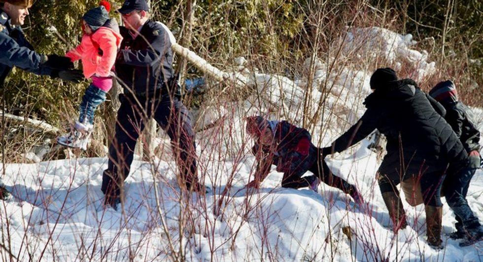 Nine people flee US border patrol to seek asylum in Canada