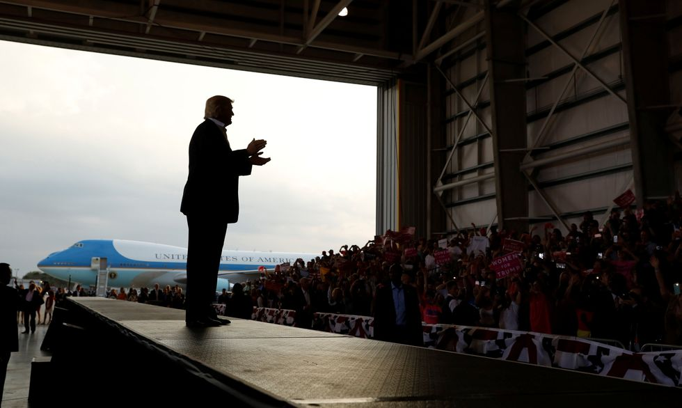 Barely 30 days in office, Trump hits the campaign trail in Florida