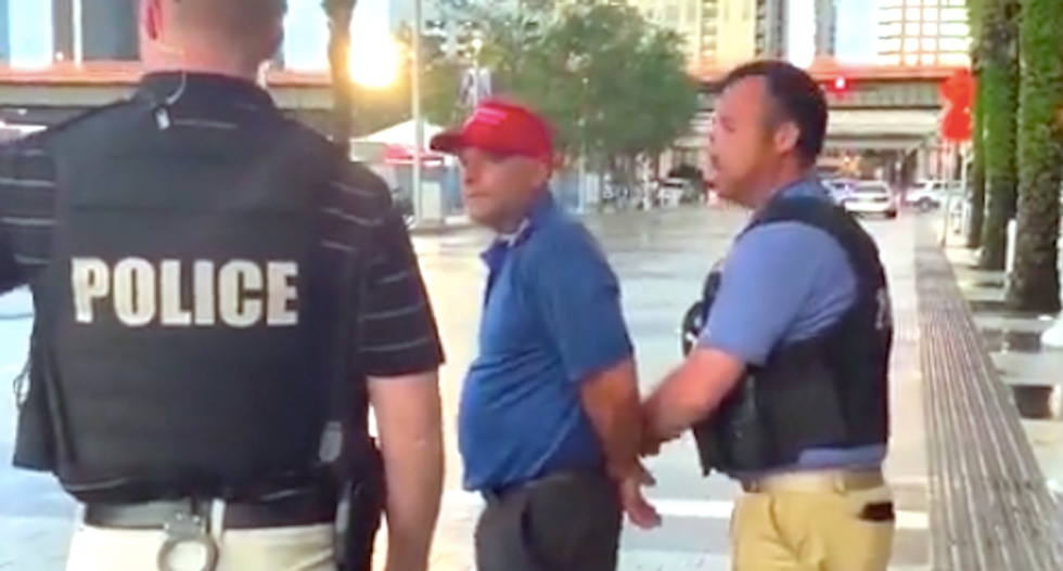 WATCH: Trump supporter arrested for smacking reporter's phone outside Orlando rally