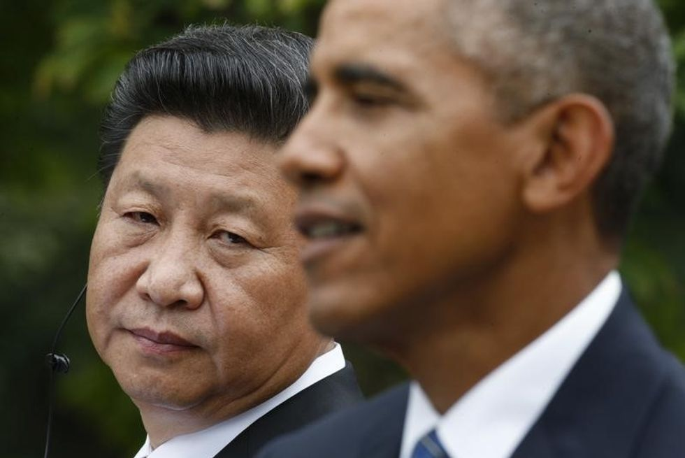 Feted in China, Xi's U.S. profile dims in shadow of pope