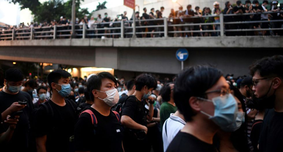 Protesters blockaded Hong Kong's police headquarters to demand Carrie Lam step down