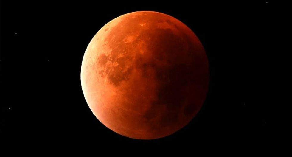 Skygazers treated to rare combined 'super blood moon' and eclipse