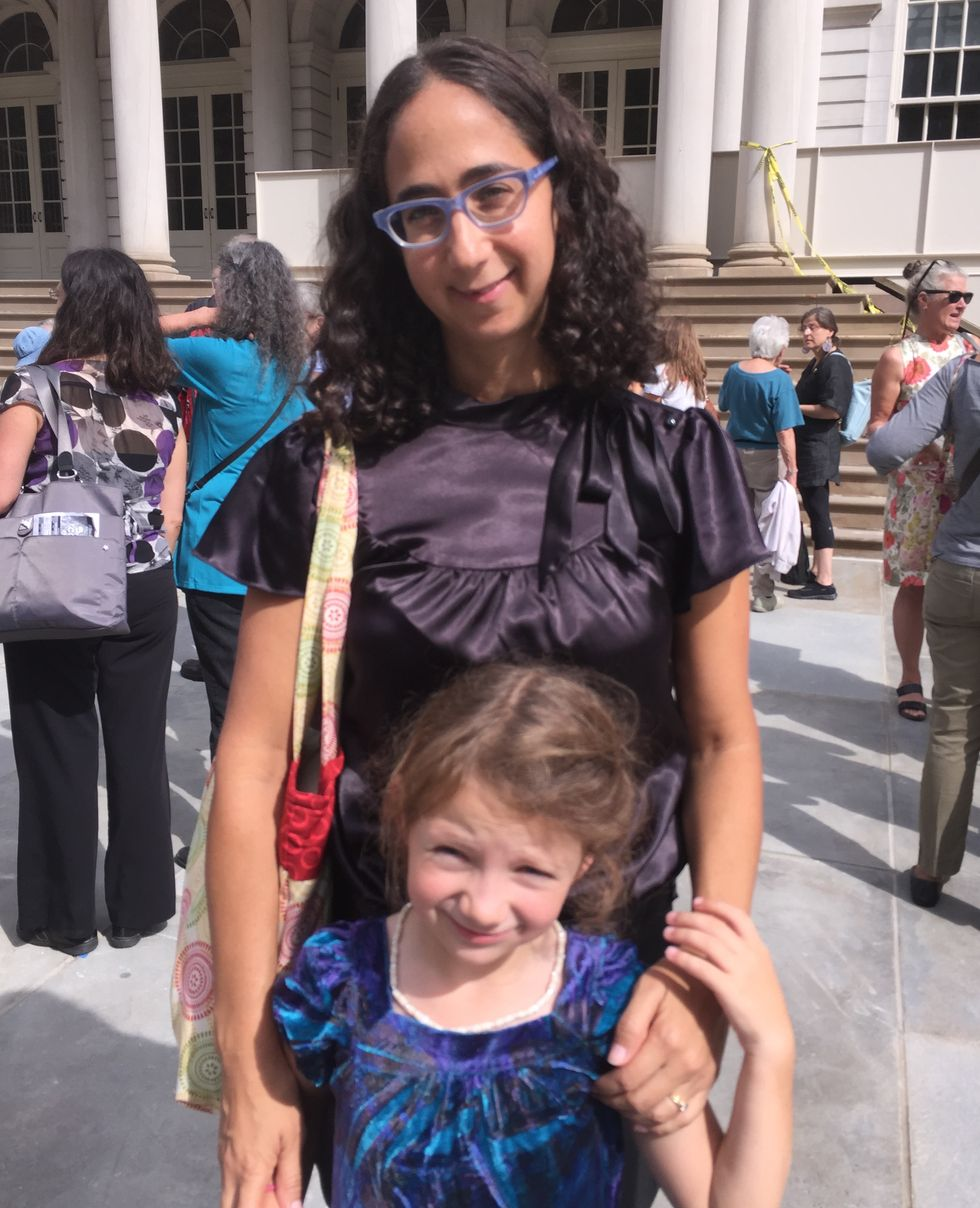 Rachel Meeropol, a lawyer with the Center for Constitutional Rights with her daughter Josie.
