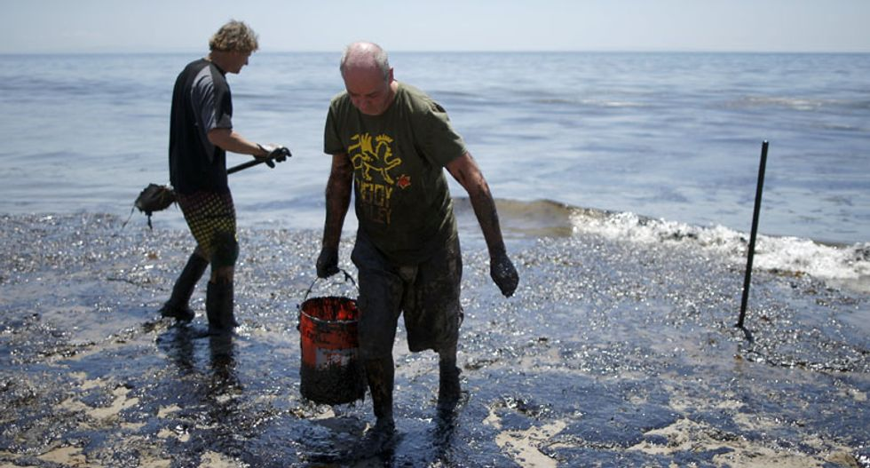 Around-the-clock cleanup effort under way after oil spill stains Santa Barbara beach